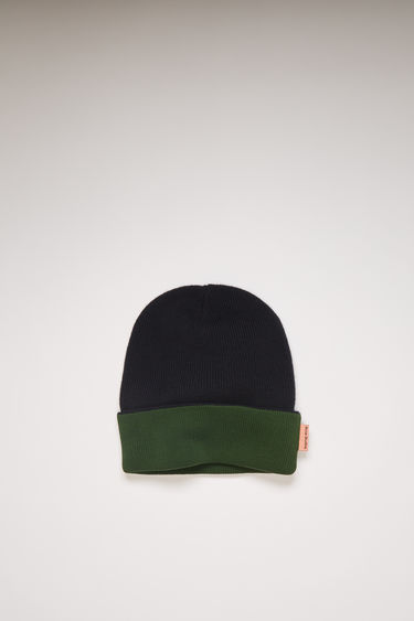 Acne Studios black/green beanie is knitted from wool in a ribbed pattern and can be worn in both ways, providing two styles in one.
