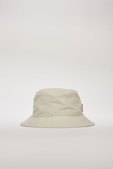 Acne Studios oat beige bucket hat is made from durable cotton-canvas and features a flat-topped crown and a quilted brim.