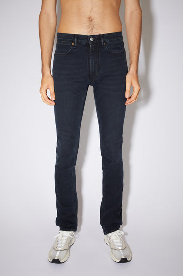 Acne Studios Max Blue Black jeans are crafted from comfort stretch denim and shaped to sit low on a waistband before falling to slim legs. They feature subtle fading and whiskering to give a worn-in effect.