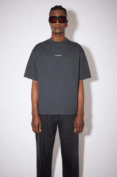 Acne Studios black crew neck t-shirt is made of cotton, featuring a front logo print.