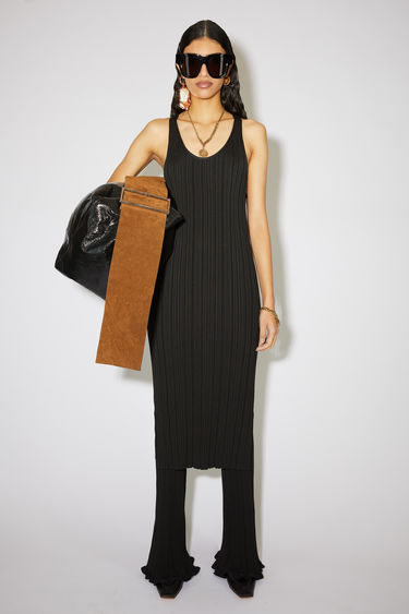 Acne Studios black scoop neck dress is made of an irregular rib knit with a straight fit.