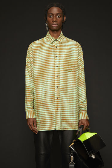 Acne Studios spearmint/toffee brown shirt is crafted from pure linen with a checked pattern and finished with a patch pocket on the chest.