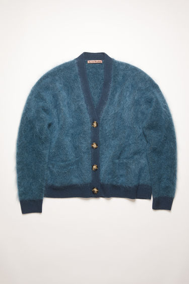 Acne Studios Rives Mohair teal blue cardigan is shaped to a loose silhouette with dropped shoulders and finished with ribbed trims.