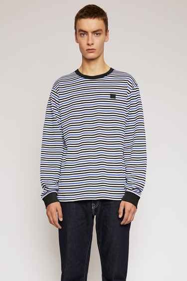 Acne Studios electric blue t-shirt is patterned with breton stripes and finished with a tonal face-embroidered patch on the chest.