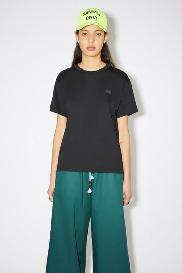 Acne Studios black crew neck t-shirt is made from organic cotton with a regular fit and a face logo patch.