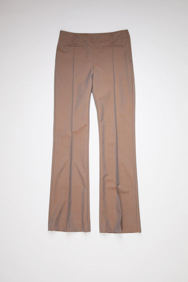 Acne Studios brown/blue suit trousers are made of iridescent wool with a boot cut fit.