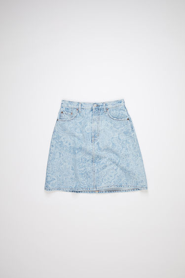 Acne Studios blue rigid denim skirt is made of cotton, featuring a paisley design lasered over a light blue wash.