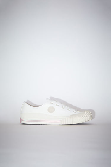 Acne Studios ivory white sneakers take cues from traditional baseball gears. They're crafted from cotton-canvas to a low-top style which laces through the front and has a rubberised logo patch on top of textured rubber soles.