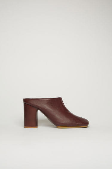 Acne Studios burgundy mules are crafted from soft lamb leather to a square-toe shape and set on a high block heel and durable rubber sole.