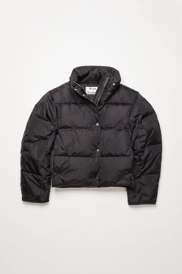 Acne Studios charcoal grey down jacket is cut to a cocoon shape from lightweight nylon and filled with insulating down for warmth.