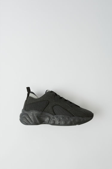 Acne Studios Manhattan Safety black sneakers are reinterpreted from the American sportswear of the '90s. They are crafted in a bulky silhouette with a textured upper.  The size runs larger, please size down than usual.