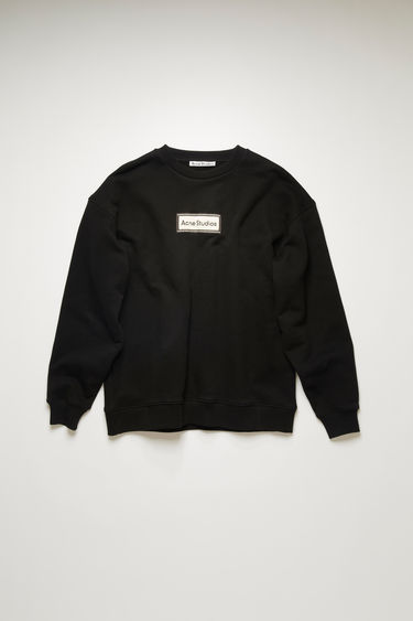 Acne Studios black sweatshirt is crafted for an oversized fit from midweight loopback jersey and adorned with a label patch on front.