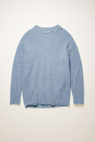 Acne Studios dusty blue sweater is crafted from soft alpaca and wool-blend to a relaxed silhouette with a deep v-neckline and finished with rolled edges around the ribbed cuffs and hem.