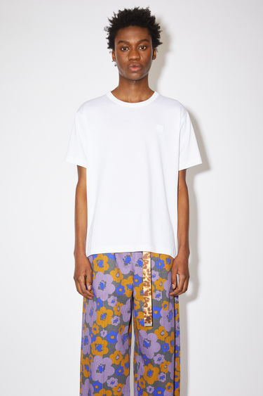 Acne Studios optic white crew neck t-shirt is made from cotton with a regular fit and a face logo patch.