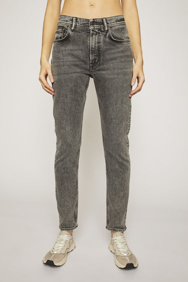 Acne Studios Blå Konst Melk Black Marble jeans are cut to sit high on the waist and shaped to a slim, tapered silhouette. They are finished with a marbled black wash.