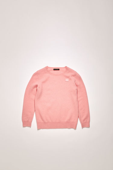 Acne Studios blush pink sweater is knitted from soft wool in a fine gauge and neatly finished with ribbed edges and a tonal face-embroidered patch.
