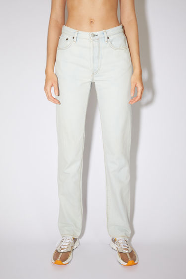Acne Studios white jeans are made from rigid denim with a high rise and a regular leg.
