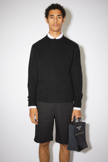 Acne Studios black sweater is knitted with soft wool and cashmere-blend yarns that's brushed by hand to create a pilled texture, then finished with ribbed cuffs, collar and hem.