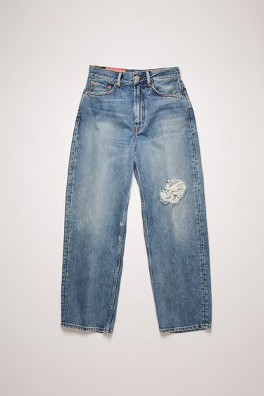 Acne Studios 1993 Blue Destroyed jeans are crafted from rigid denim that's whiskered and distressed for a time-worn effect. They're cut to a super high-rise silhouette with tapered legs that crop above the ankles.