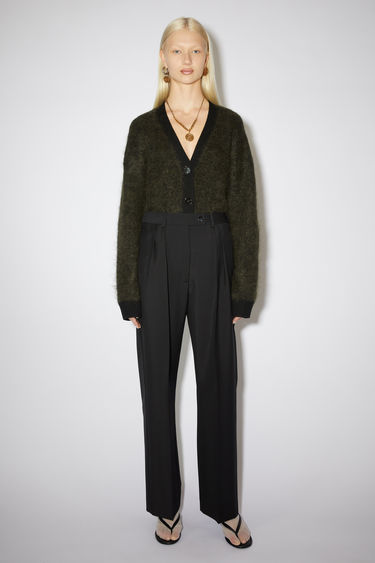Acne Studios black wide leg suit trousers are made of a wool/mohair blend with large pleats.