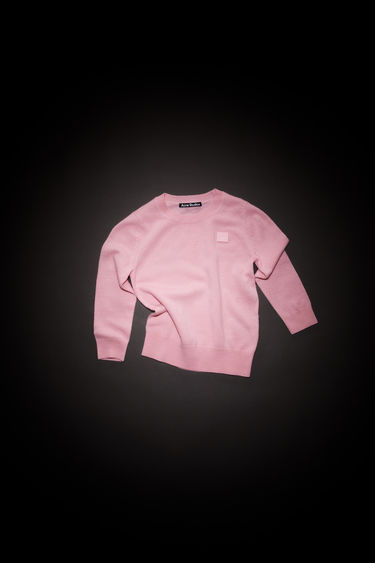 Acne Studios children's blush pink crew neck sweater is made from wool with a face logo patch and ribbed details.