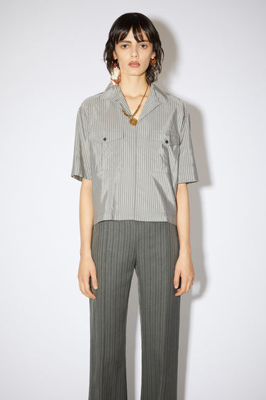 Acne Studios dark grey short sleeve shirt is made of a striped cotton blend with a boxy fit.