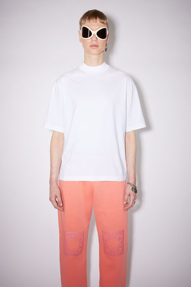 Acne Studios optic white mock neck t-shirt is made of cotton, featuring an Acne Studios logo tab on the lower side.