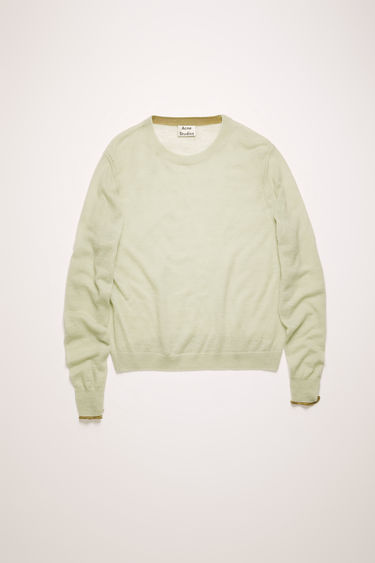 Acne Studios pastel green sweater is knitted from crafted from lightweight wool and alpaca-blend to a fine-gauge knit. It's shaped to a relaxed silhouette with a round neckline and dropped shoulder seams.