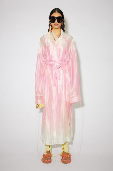 Acne Studios faded pink shiny organza coat is made of an acetate/silk blend with a belted waist.
