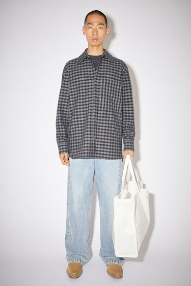 Acne Studios black/carbon grey pocket overshirt is made of a checked cotton/wool blend and has a boxy fit.