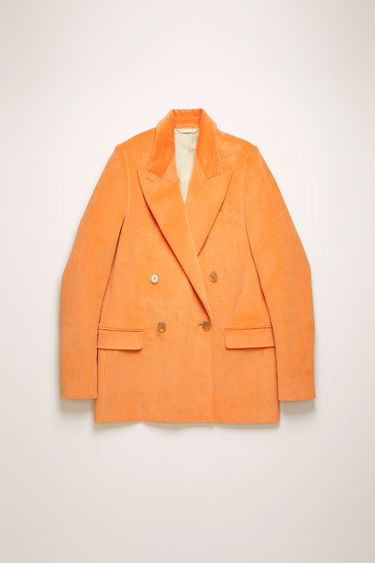 Acne Studios peach orange corduroy suit jacket is crafted to a double-breasted silhouette with wide notch lapels and flap pockets, then complete with a single back vent.