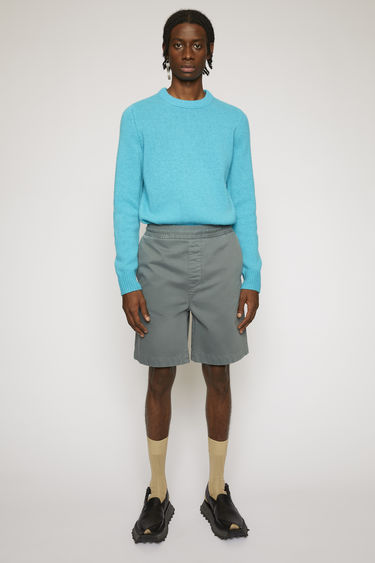 Acne Studios dusty green shorts are cut from a soft cotton twill with a high-rise waist and straight legs and finished with an elasticated waistband.