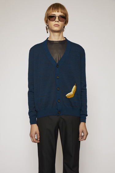 Acne Studios navy cardigan is knitted with elements of soft alpaca and wool in tonal stripes and features a banana jacquard on the bottom corner.