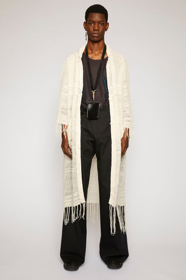 Acne Studios off white cardigan is loosely woven from a hemp-blend loop yarn and features fringed trims along the hemline, cuffs and pockets.