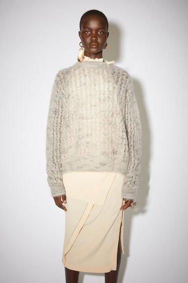 Acne Studios grey crew neck sweater is made of a sheer, open knit mohair blend with a classic fit.