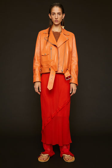 Acne Studios New Merlyn peach orange jacket is crafted to a classic biker silhouette from soft lamb leather and features traditional peak lapels, a broad-belted waist and a D-shaped front pocket.