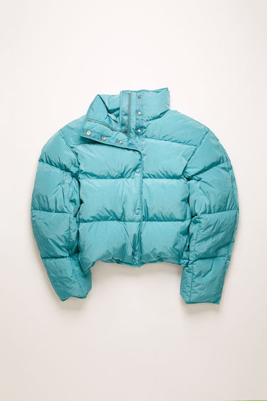 Acne Studios ocean blue down jacket is cut to a cocoon shape from lightweight nylon and filled with insulating down for warmth.