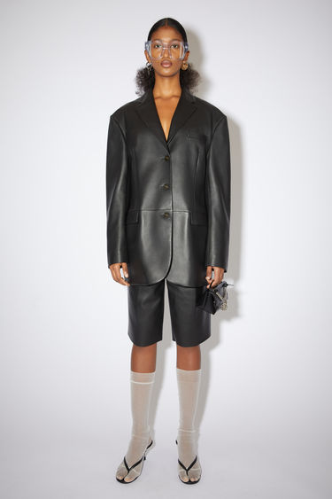 Acne Studios black blazer jacket is made of leather with a relaxed fit.
