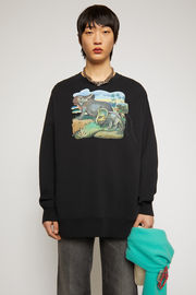 Acne Studios black sweatshirt is crafted to an oversized silhouette from organically grown cotton and features a dinosaur print and a patch adorned on front.
