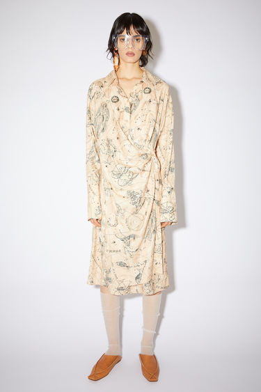 Acne Studios beige printed shirt dress is made of viscose and features an asymmetrical button placket.
