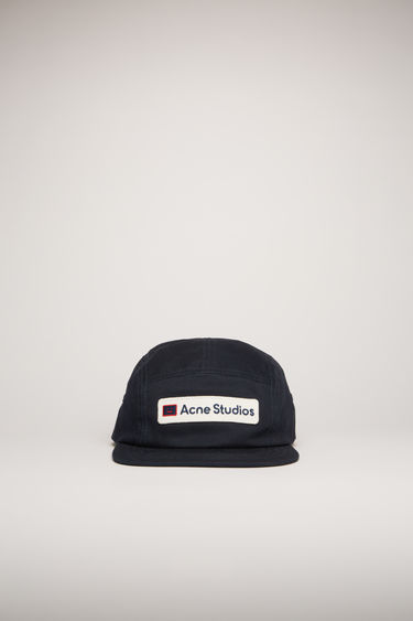 Acne Studios dark navy cap is crafted from cotton to a five-panel shape with a flat brim and accented with a twill logo patch on the front.