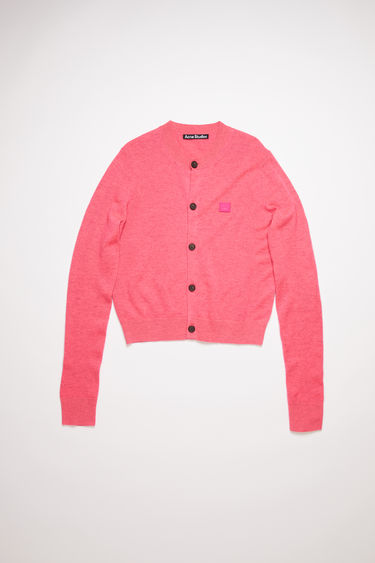 Acne Studios neon pink crew neck cardigan sweater is made from wool with a face logo patch and ribbed details.