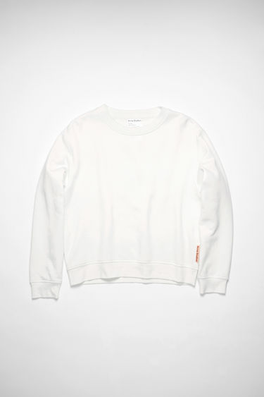 Acne Studios optic white sweatshirt is cut from brushed cotton jersey with ribbed trims and has a pink logo-jacquard tab sewn on the side seam.