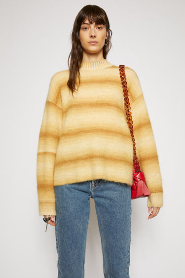 Acne Studios sand beige sweater is knitted from alpaca and mohair-blend and features ombre-jacquard stripe pattern. It's shaped to a relaxed, boxy shape with dropped sleeves, then finished with ribbed edges.