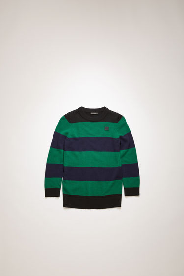 Acne Studios black/multi striped sweater is finely knitted from wool and finished with an embroidered face patch and ribbed trims.