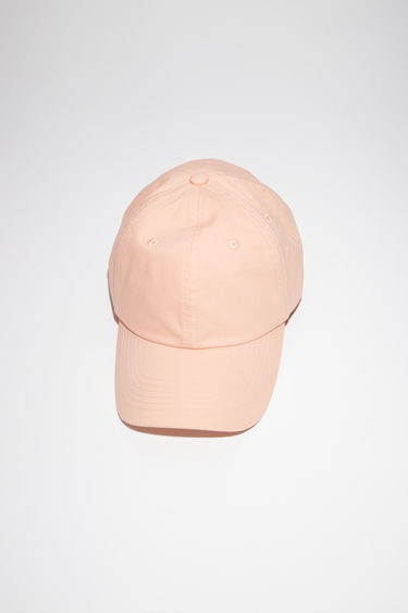 Acne Studios light pink 6 panel baseball cap is made of a light cotton twill with a tonal face patch.