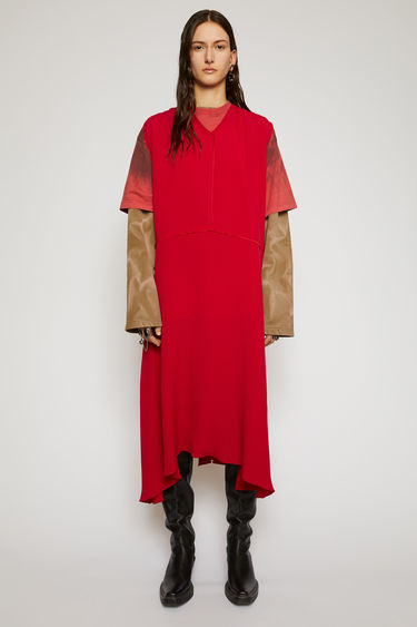 Acne Studios cherry red sleevess dress is made from silk-blend crepe that falls in a fluid drape. It's shaped with a lightly gathered neckline that dips to a V at the front and has an asymmetric midi-length hem.