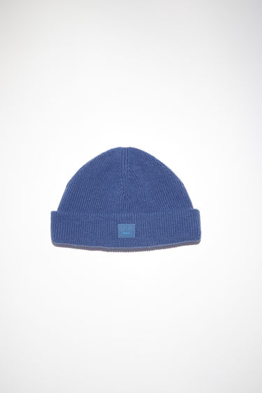 Acne Studios dusty blue beanie hat is made from rib knit wool with a face logo patch.