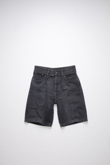 Acne Studios black denim shorts are made of cotton with a thin belt.