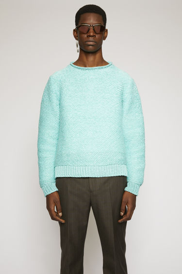 Acne Studios turquoise blue sweater is knitted with thick yarns to an oversized fit and finished with ribbed cuffs and hem.
